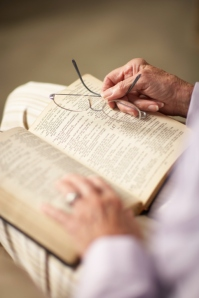 Old person reading Bible